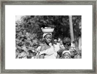 Girl In The Marketplace, Ivory Coast Framed Print by The Harrington Collection