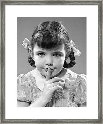 Girl Making Shushing Gesture, C.1940s Framed Print