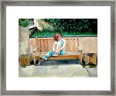 Girl On A Bench Framed Print
