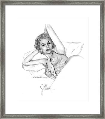 Girl On A Pillow Framed Print