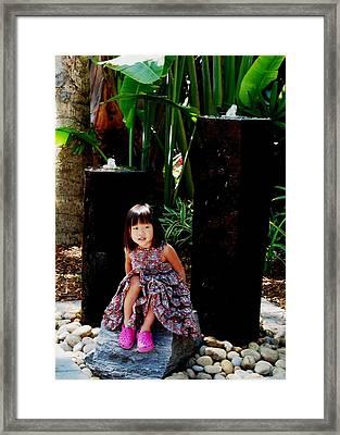 Girl On Rocks Framed Print
