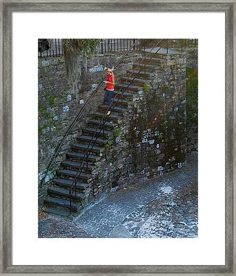 Girl On Stairs Framed Print