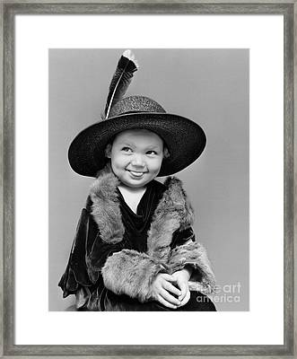 Girl Playing Dress-up And Making Framed Print