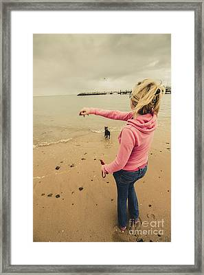 Girl Playing Fetch On Overcast Day Framed Print