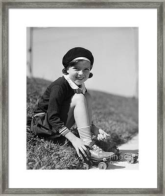 Girl Putting On Roller Skates, C.1930s Framed Print by H. Armstrong Roberts/ClassicStock