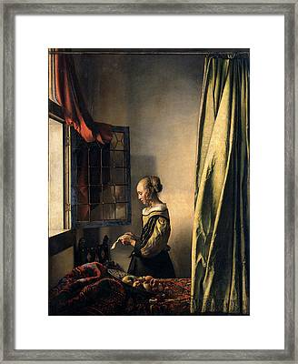 Girl Reading A Letter By An Open Window Framed Print by Jan Vermeer