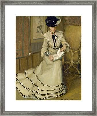 Girl Reading Framed Print by Frederick Carl Frieseke