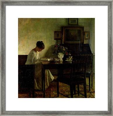Girl Reading In An Interior  Framed Print by Carl Holsoe