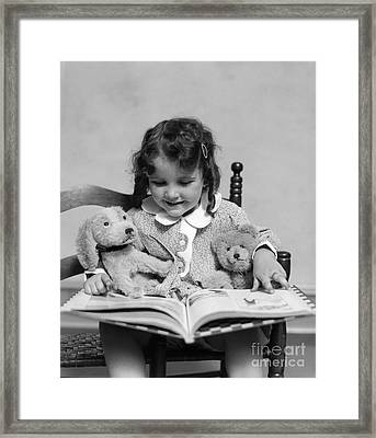 Girl Reading Storybook, C.1930s Framed Print by H. Armstrong Roberts/ClassicStock