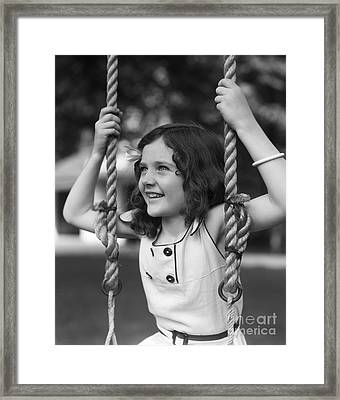 Girl Sitting On A Swing, C.1930s Framed Print by H. Armstrong Roberts/ClassicStock