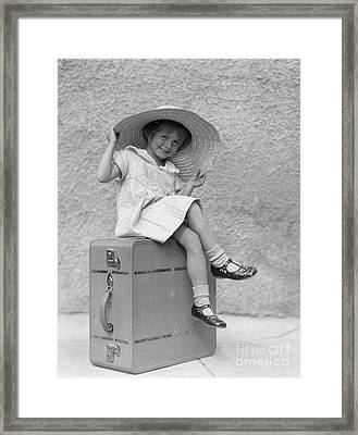 Girl Sitting On Suitcase With Big Straw Framed Print by H. Armstrong Roberts/ClassicStock