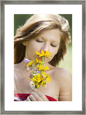 Girl Smelling Flowers Framed Print by Wolfgang Steiner