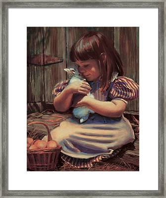 Girl With A Bunny Framed Print