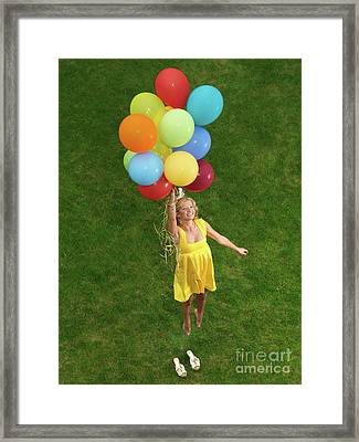 Girl With Air Balloons Framed Print