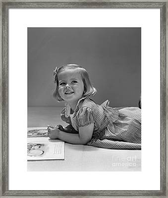 Girl With Picture Book, C.1940s Framed Print