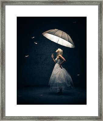 Girl With Umbrella And Falling Feathers Framed Print