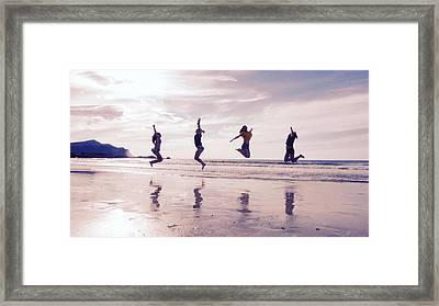Girls Jumping On Lofoten Beach Framed Print by Tamara Sushko