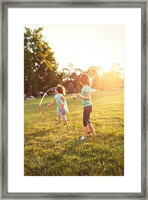 Girls Playing Together On Evening Lawn Framed Print