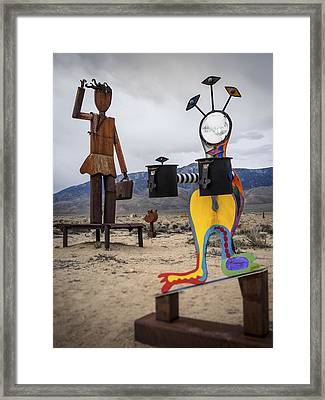 Give And Take Framed Print by Steve Spiliotopoulos