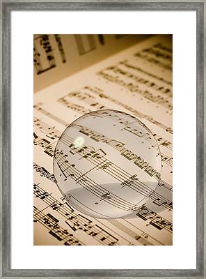 Glass Ball On Sheet Music Framed Print by Utah Images