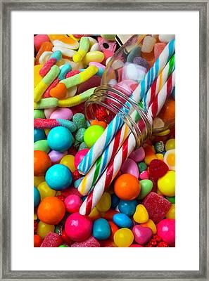 Glass Jar Spilling Candy Framed Print by Garry Gay