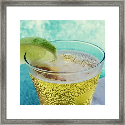 Glass Of Beber With Lime By A Pool Framed Print