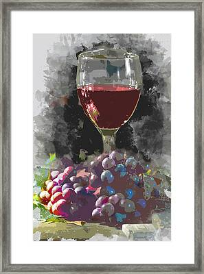 Glass Of Wine And A Mound Of Grapes In The Wine Cellar Framed Print by Elaine Plesser
