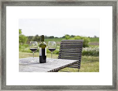 Glasses And A Bottle Of Red Wine On An Outdoor Setting Framed Print