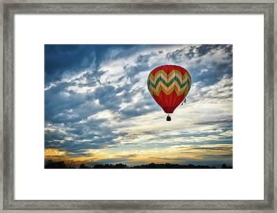 Gliding Through Sunset Framed Print