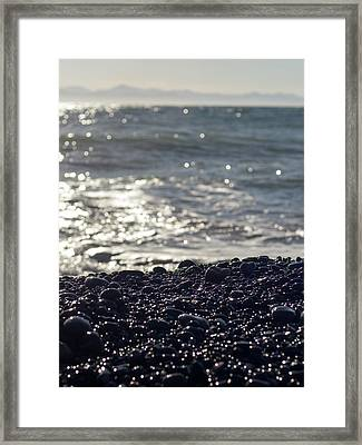 Glistening Rocks And The Ocean Framed Print