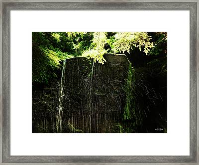 Glowing Drops Framed Print by Leland D Howard