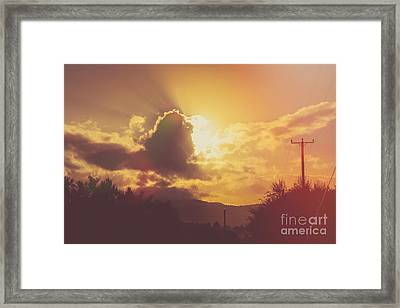Glowing Orange Hilltop View Of An Afternoon Sunset Framed Print