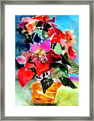 Glowing Poinsettias Framed Print by Mindy Newman