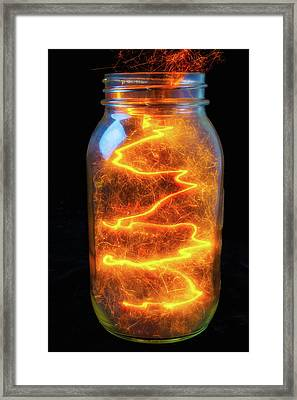 Glowing Sparks In A Jar Framed Print