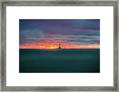 Glowing Sunset On Lake With Lighthouse Framed Print