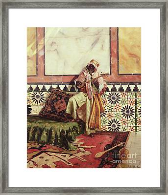 Gnaoua In A North African Interior Framed Print by Rudolphe Ernst