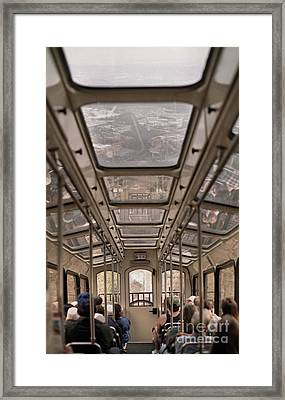 Going Down Framed Print by Richard Rizzo