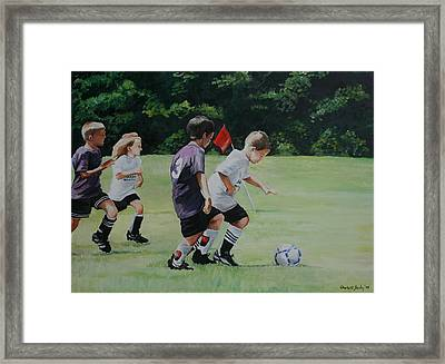 Going For The Goal Framed Print