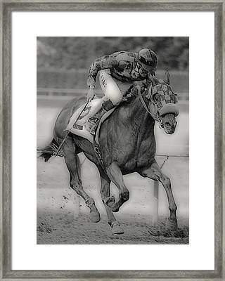 Going For The Win Framed Print by Lori Seaman