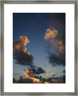 Gold Clouds  Framed Print by Chad Natti