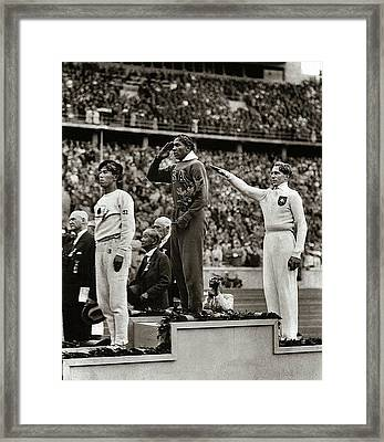Gold Medal Winner Jesse Owens Saluting While German Gives Nazi Salute Olympics Berlin 1936 Framed Print by David Lee Guss