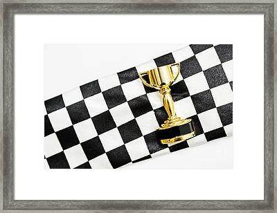 Gold Trophy On A Checked Sport Flag Framed Print