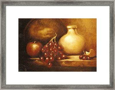 Golden Carafe Framed Print