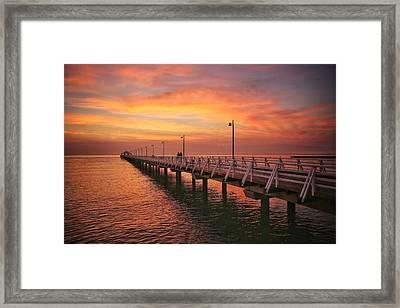 Golden Red Skies Over The Pier Framed Print
