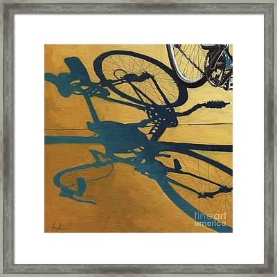 Golden Shadows - Wheels Framed Print