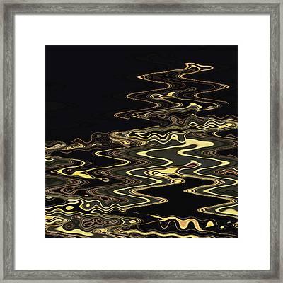 Golden Shimmers On A Dark Sea Framed Print