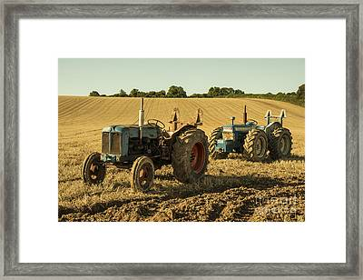 Golden Tractors  Framed Print by Rob Hawkins
