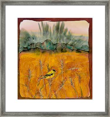 Goldfinch In The Wheat Framed Print by Carolyn Doe