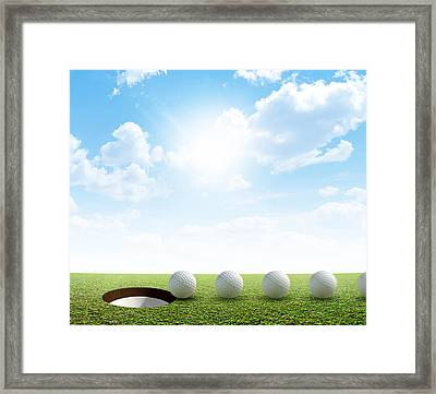 Golf Hole And Ball Putt Path Framed Print by Allan Swart