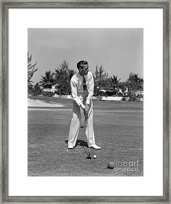 Golfer Teeing Off, Miami, Florida Framed Print by H. Armstrong Roberts/ClassicStock